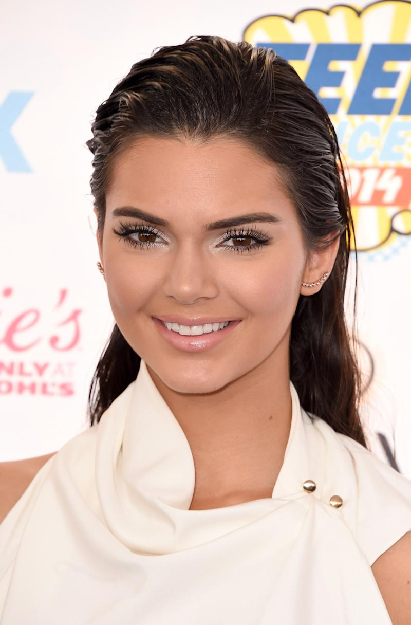 At the Teen Choice Awards in 2014, Jenner ditches her natural waves and fresh face for a frosted look, with slicked-back hair and shimmery neutrals.