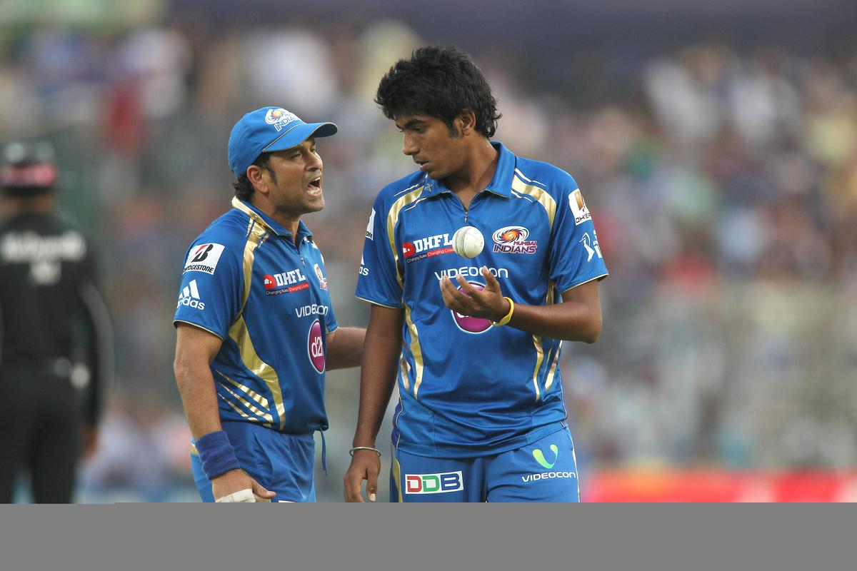 Sachin Tendulkar of Mumbai Indians encourages Jasprit Bumrah of Mumbai Indians during match 28 of the Pepsi Indian Premier League between The Delhi Daredevils and the Mumbai Indians held at the Feroz Shah Kotla Stadium, Delhi on the 21st April 2013.  (BCCI)