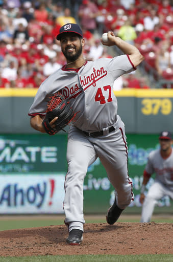 Washington Nationals starting pitcher Gio Gonzalez throws against the Cincinnati Reds in the first inning of a baseball game on Saturday, July 26, 2014, in Cincinnati. (AP Photo/David Kohl)