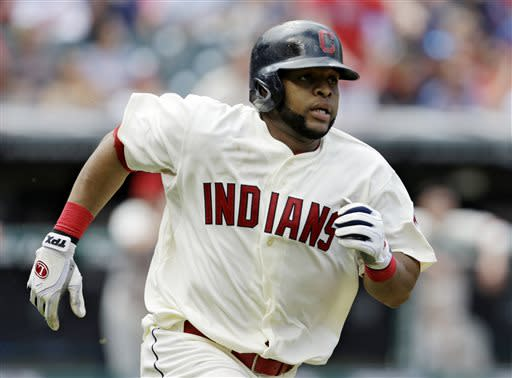 Cleveland Indians' Carlos Santana runs the bases after hitting an RBI double off Kansas City Royals starting pitcher James Shields in the third inning of a baseball game, Sunday, July 14, 2013, in Cleveland. Michael Brantley scored. (AP Photo/Tony Dejak)