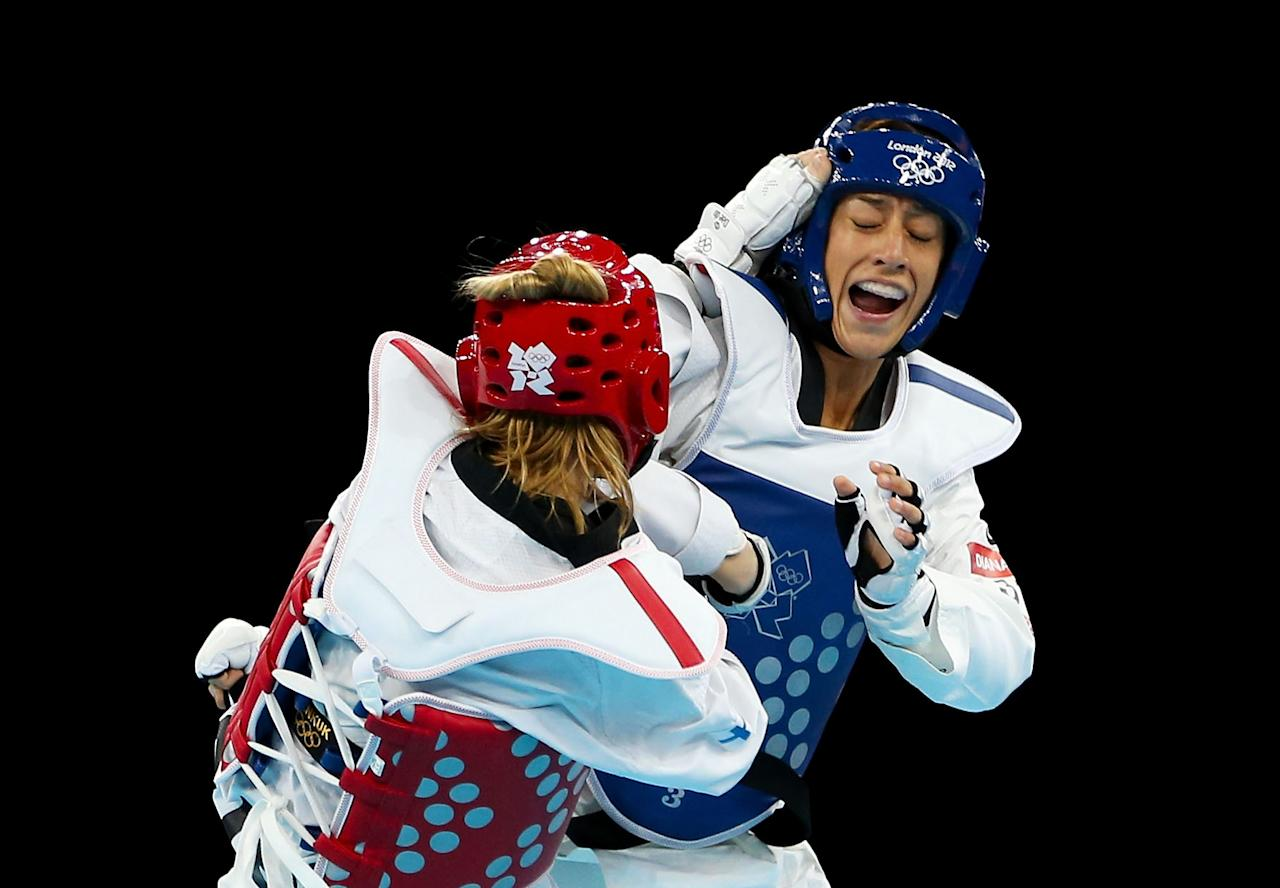 LONDON, ENGLAND - AUGUST 09:  (L-R) Suvi Mikkonen of Finland competes against Diana Lopez of the United States during the Women's -57kg Taekwondo repechage on Day 13 of the London 2012 Olympic Games at ExCeL on August 9, 2012 in London, England.  (Photo by Hannah Johnston/Getty Images)
