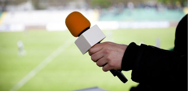 sports reporter with microphone