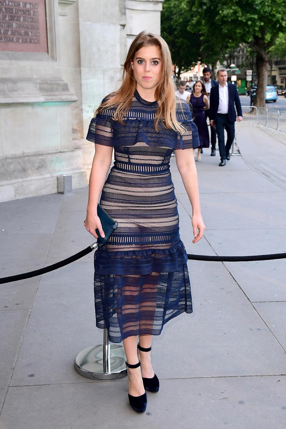 <p>The royal showed off her flair for fashion in a dress by cool-girl brand Self Portrait. <br><em>[Photo: PA]</em> </p>