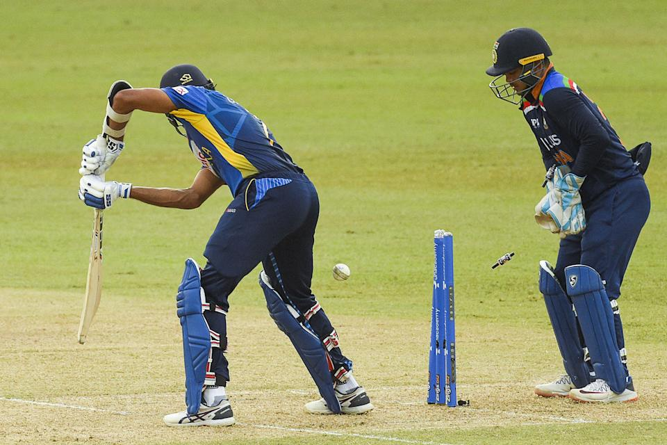 Sri Lanka's cricket captain Dasun Shanaka (L) is dismissed by India's Yuzvendra Chahal (not pictured) as India's Ishan Kishan (R) looks on during the second one-day international (ODI) cricket match between Sri Lanka and India at the R.Premadasa Stadium in Colombo on July 20, 2021. (Photo by ISHARA S.  KODIKARA / AFP) (Photo by ISHARA S.  KODIKARA/AFP via Getty Images)