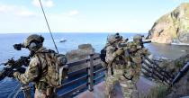 In this photo provided by South Korea's Navy, members of South Korean Navy's special forces participate during the drill on the islets called Dokdo in Korean and Takeshima in Japanese, Sunday, Aug. 25, 2019. In a development that could possibly further complicate ties between Seoul and Tokyo, South Korea's navy on Sunday began two-day exercises on and around a group of islets controlled by South Korea but also claimed by Japan.(South Korea's Navy via AP)