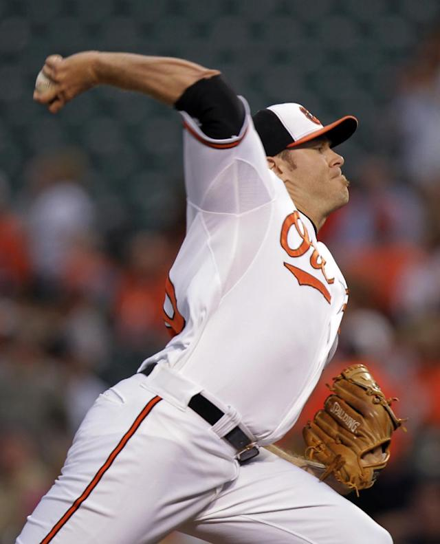 Baltimore Orioles starting pitcher Chris Tillman delivers the ball to the New York Yankees during the first inning of a baseball game, Monday, Sept. 9 2013, in Baltimore. (AP Photo/Luis M. Alvarez)