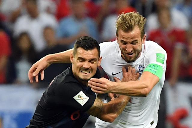 <p>Croatia's defender Dejan Lovren (L) challenges England's forward Harry Kane during the Russia 2018 World Cup semi-final football match between Croatia and England at the Luzhniki Stadium in Moscow on July 11, 2018. (Photo by YURI CORTEZ / AFP) </p>