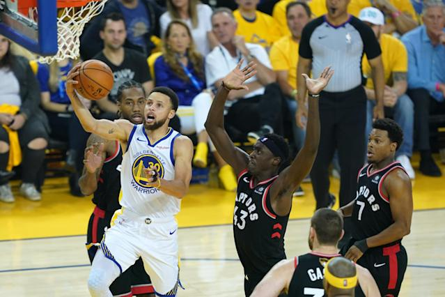 Stephen Curry #30 of the Golden State Warriors attempts a shot against the Toronto Raptors in the first half during Game Three of the 2019 NBA Finals at ORACLE Arena on June 05, 2019 in Oakland, California. (Photo by Thearon W. Henderson/Getty Images)