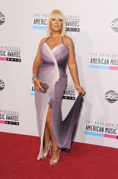 Christina Aguilera arrives on the 2012 American Music Awards red carpet.