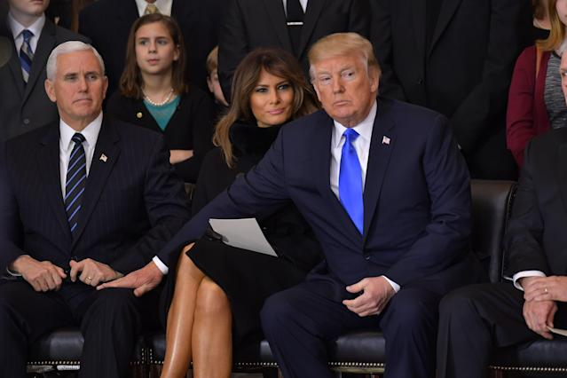 <p>President Donald Trump (R)reaches for Vice President Mike Pence as US First Lady Melania Trump looks on, during the memorial service for Reverend Billy Graham in the Rotunda of the U.S. Capitol on Feb. 28, 2018 in Washington. (Photo: Mandel NganAFP/Getty Images) </p>