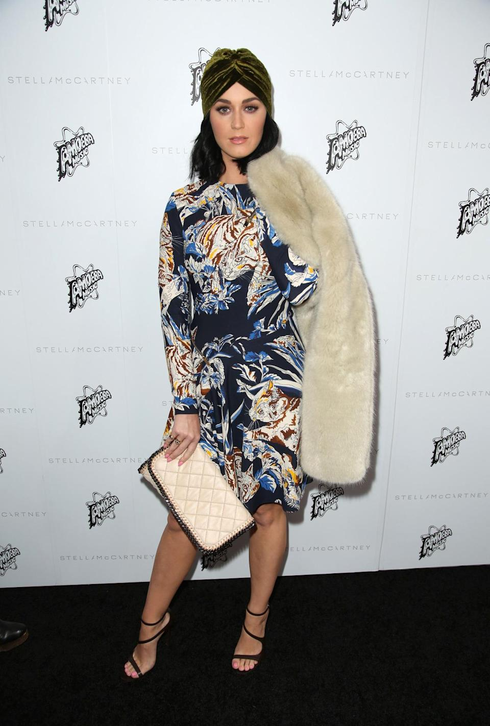 <p>We're a little bit in love with Katy Perry's turban and faux fur shawl combo, but hazard a guess that it won't be to everyone's taste.<i> [Photo: Rex]</i></p>