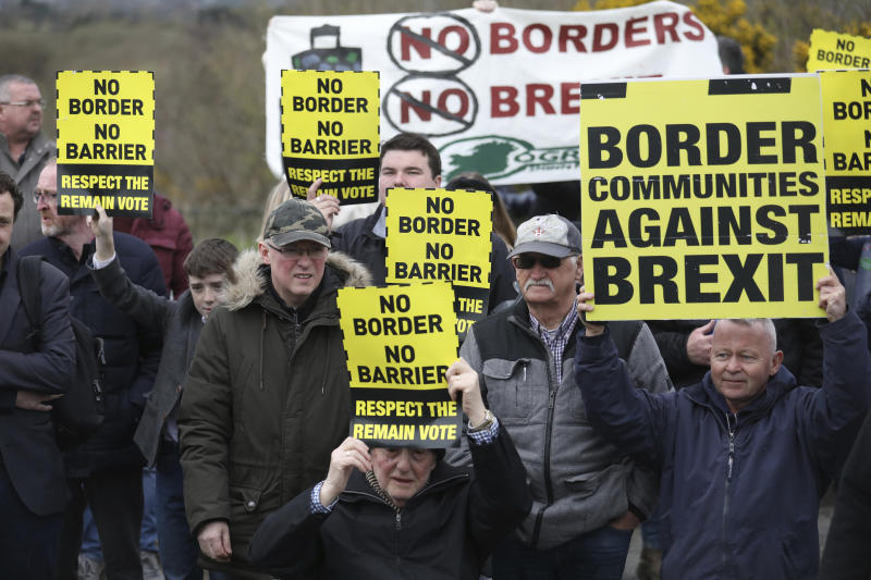 Anti Brexit demonstrators protest on the Irish border on the Old Dublin Road, Carrickcarnon, Ireland, Saturday, March 30, 2019. Border communities protested against Brexit by holding various rallies around Ireland. (AP Photo/Peter Morrison)