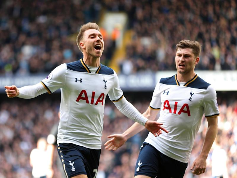 Eriksen celebrates his fine opening goal: Getty
