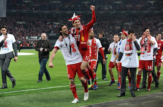 Andy Carroll and Maxi Rodriguez celebrate winning the 2012 League Cup