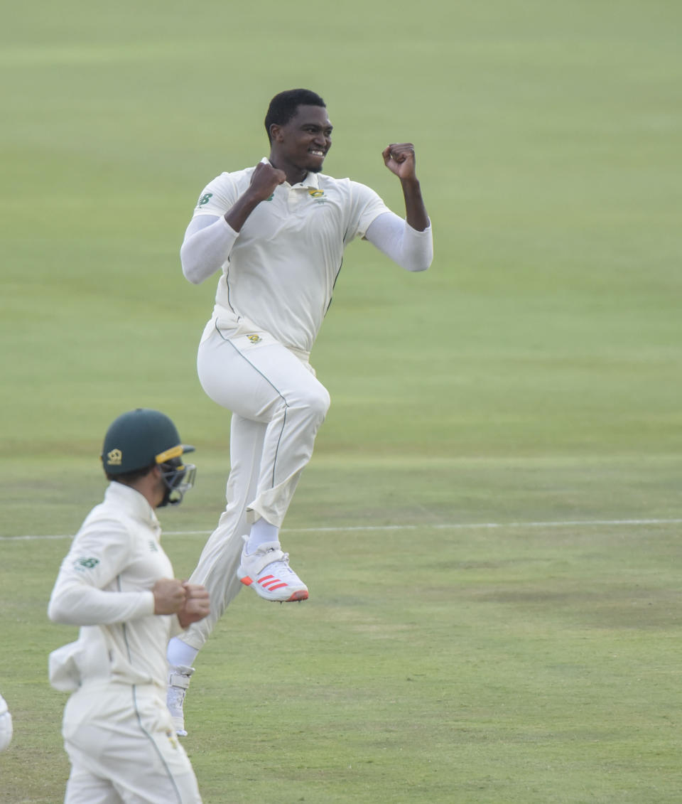 South Africa's Lungi Ngidi celebrates his second wicket on day three of the first cricket test match between South Africa and Sri Lanka at Super Sport Park Stadium in Pretoria, South Africa, Monday Dec. 28, 2020. (AP Photo/Catherine Kotze)