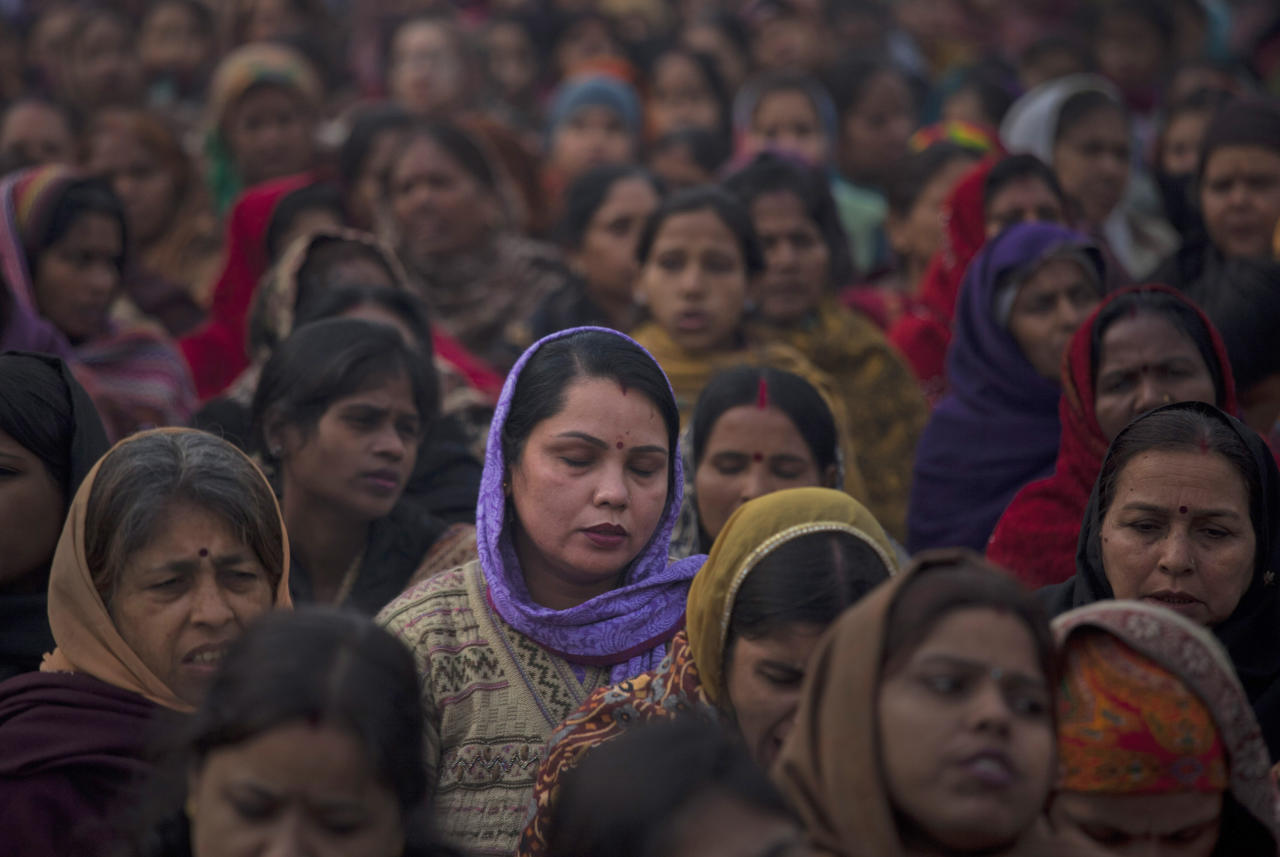Indian women offer prayers for a gang rape victim at Mahatma Gandhi memorial in New Delhi, India, Wednesday, Jan. 2, 2013. India's top court says it will decide whether to suspend lawmakers facing sexual assault charges as thousands of women gathered at the memorial to independence leader Mohandas K. Gandhi to demand stronger protection for their safety. (AP Photo/ Dar Yasin)