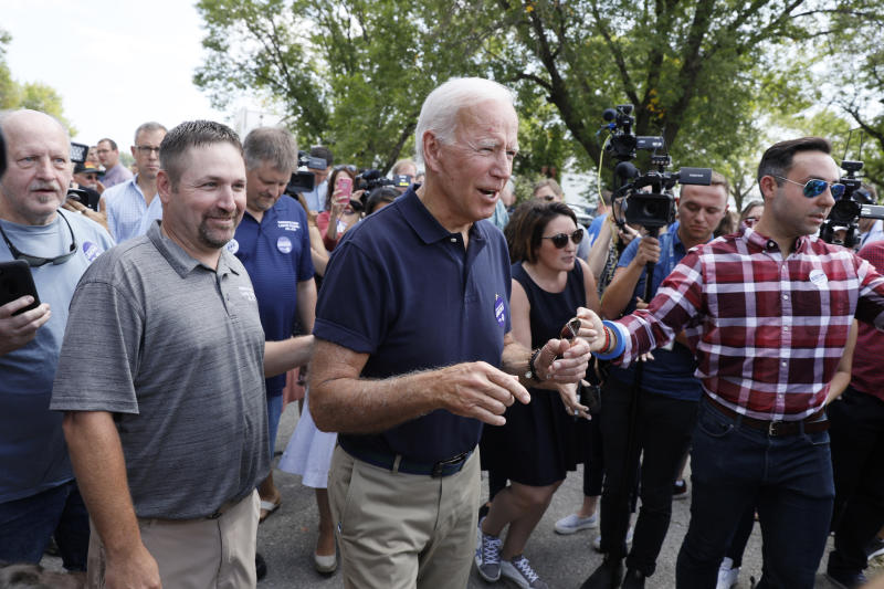 Democratic presidential candidate former Vice President Joe Biden greets local residents during the Hawkeye Area Labor Council Labor Day Picnic, Monday, Sept. 2, 2019, in Cedar Rapids, Iowa. (AP Photo/Charlie Neibergall)