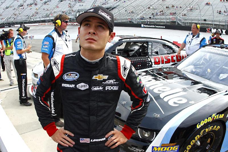 FILE - In this Aug. 23, 2013, file photo, driver Kyle Larson looks up during qualifying for the NASCAR Nationwide series auto race in Bristol, Tenn. Larson has been tapped to replace Juan Pablo Montoya in the No. 42 car at Earnhardt Ganassi Racing. The announcement was made Friday, Aug. 30, 2013, at Atlanta Motor Speedway, where the 21-year-old Larson will compete this weekend in a Nationwide Series race. (AP Photo/Wade Payne, File)