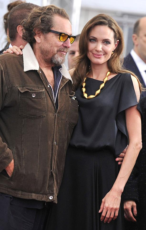 "<a href=""http://movies.yahoo.com/movie/contributor/1800020495"">Julian Schnabel</a> and <a href=""http://movies.yahoo.com/movie/contributor/1800019275"">Angelina Jolie</a> at the New York premiere of <a href=""http://movies.yahoo.com/movie/1810186173/info"">In the Land of Blood and Honey</a> on December 5, 2011."
