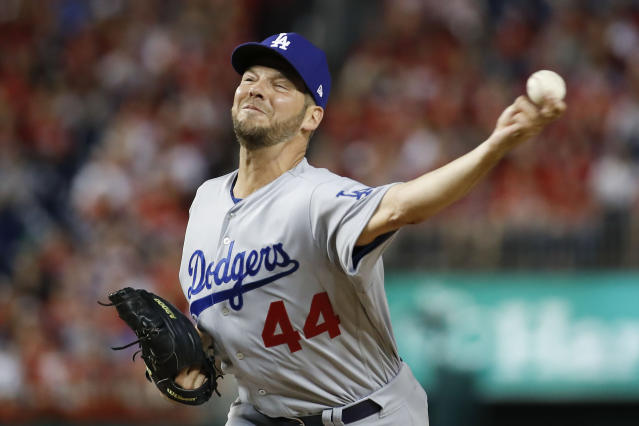 FILE - In this Oct. 7, 2019, file photo, Los Angeles Dodgers starting pitcher Rich Hill throws against the Washington Nationals during the first inning in Game 4 of a baseball National League Division Series in Washington. Hill has won the Tony Conigliaro Award. The honor goes to a major leaguer who has overcome adversity through the attributes of spirit, determination and courage that were the trademarks of Tony C. (AP Photo/Alex Brandon, File)