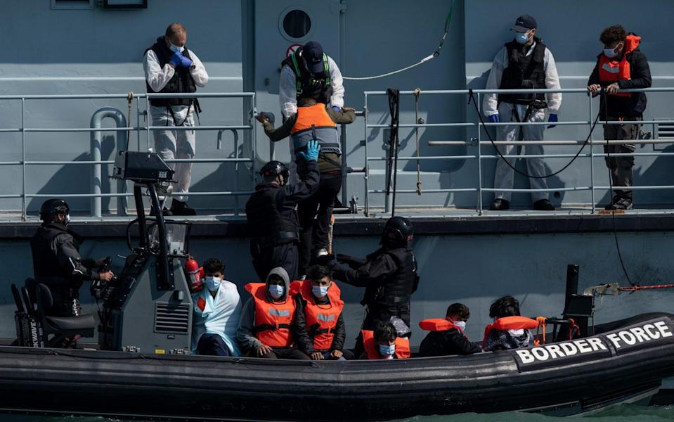 Border Force officials move newly arrived Channel migrants between vessels outside Dover Harbour in Kent - Dan Kitwood/Getty Images