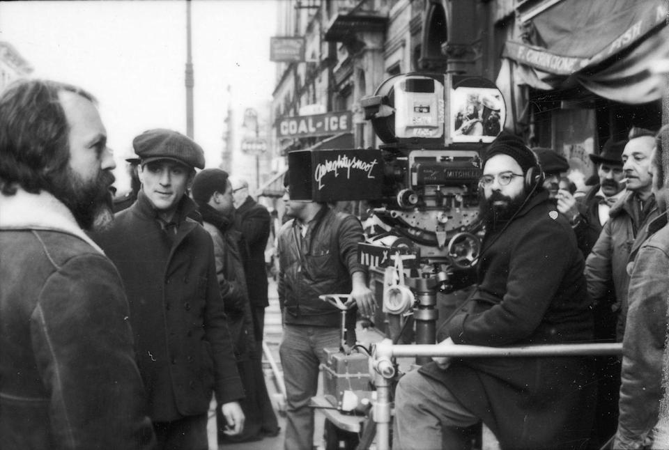 <p>Soon after the success of <em>The Godfather, </em>a sequel was in the works. Here, director Francis Ford Coppola is seen behind the camera, while Robert De Niro stands in front of the lens.</p>