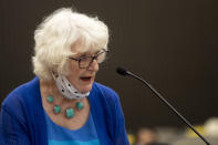 Dolly Kreis, the mother of Debbie Strauss, makes her statement as Joseph James DeAngelo, known as the Golden State Killer, is in the courtroom during the first day of victim impact statements Tuesday, Aug. 18, 2020, in Sacramento, Calif. DeAngelo will be formally sentenced to life in prison Friday. He has admitted to 13 murders and nearly 50 rapes between 1975 and 1986. DeAngelo broke into Strauss' home and raped her in October 1977. Strauss died from cancer in 2006. Throughout each impact statement, DeAngelo did not make eye contact and stared at a wall away from the people and families he victimized. (Santiago Mejia/San Francisco Chronicle via AP, Pool)