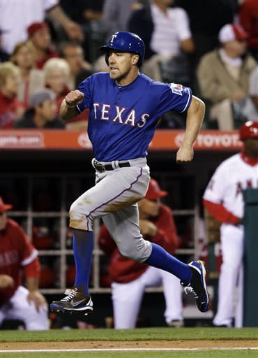 Texas Rangers' David Murphy runs toward home plate to score on a double hit by Mitch Moreland during the sixth inning of a baseball game against the Los Angeles Angels in Anaheim, Calif., Monday, April 22, 2013. (AP Photo/Jae C. Hong)