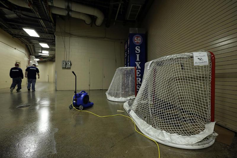 FILE - In a Tuesday, Jan. 15, 2013 file photo, freshly painted hockey goals are =drying at the Wells Fargo Center, home to the Philadelphia Flyers, in Philadelphia. The lockout that lasted 119 days has ended, the new collective bargaining agreement is in place and the NHL is finally about to play games again after hastily arranged week-long training camps around the league. The Flyers will host the Pittsburgh Penguins Saturday to open the lockout-shortened NHL season. (AP Photo/Matt Slocum, File)