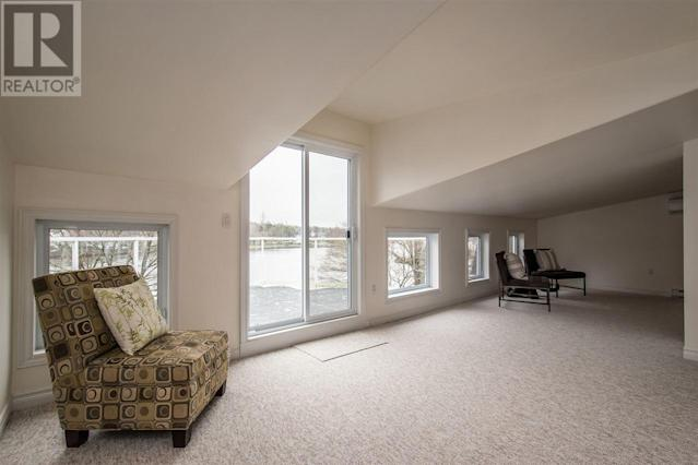 <p><span>10 Armshore Drive, Halifax, N.S.</span><br> On the third level of this four-level home, you'll find a multipurpose room, ideal to be turned into a family room. It opens to a private balcony. (Photo: Zoocasa) </p>