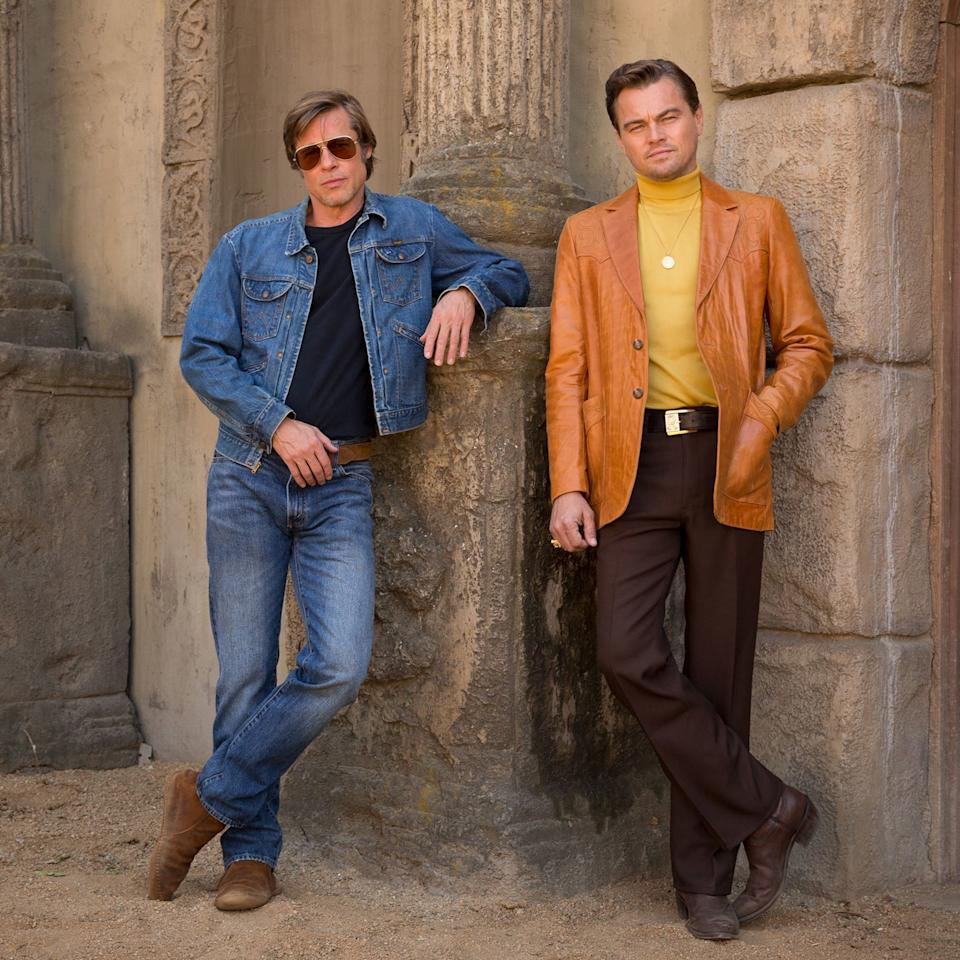 Brad Pitt makes his first appearance (as Rick's stunt double and best friend Cliff) pulling off denim on denim as few can; DiCaprio's slightly fussier star layers a leather jacket over a turtleneck in one of the <em>Once</em>'s favorite colors — keep an eye out for more sunny California yellow ahead.