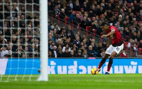 <span>Marcus Rashford of Manchester United scores the opening goal</span> <span>Credit: MB Media/Getty Images </span>