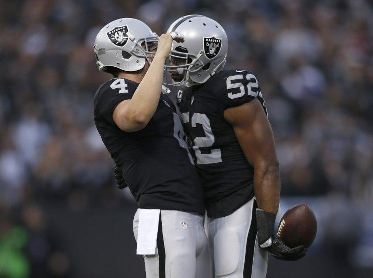 7df3294d Khalil Mack (52), celebrating with Derek Carr, helped the Raiders get their