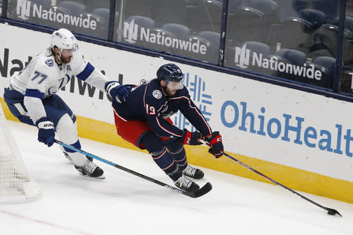 Tampa Bay Lightning's Victor Hedman, left, of Sweden, chases Columbus Blue Jackets' Liam Foudy behind the net during the second period of an NHL hockey game Saturday, Jan. 23, 2021, in Columbus, Ohio. (AP Photo/Jay LaPrete)