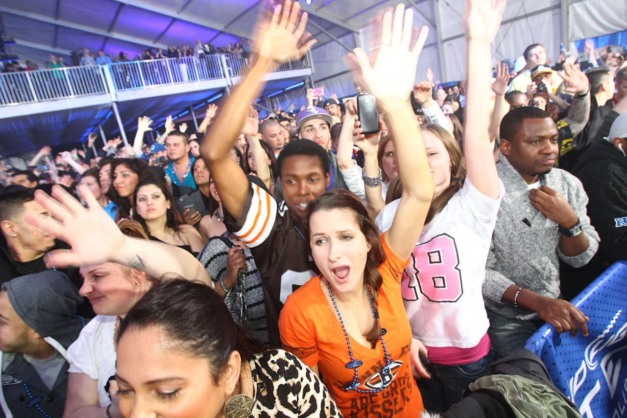 Football fans enjoy performances from 50 Cent and Pitbull at the Bud Light Hotel concert.