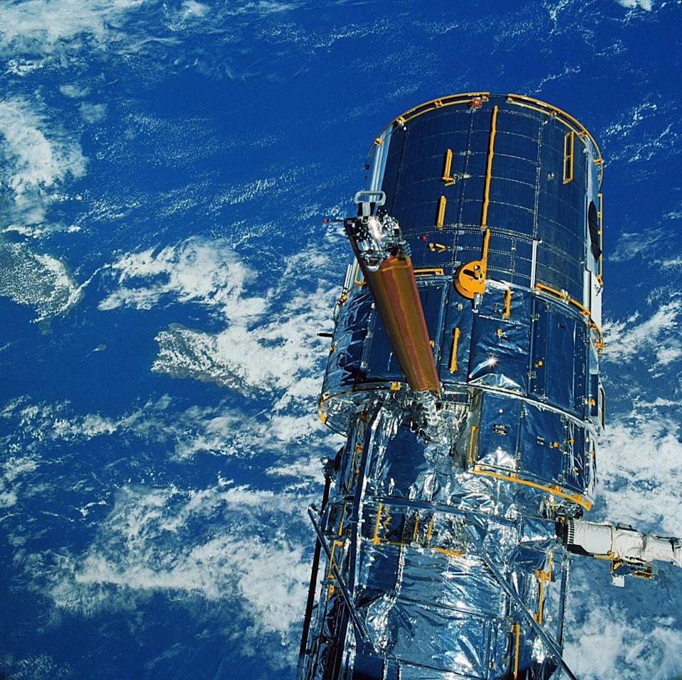 """<p>The <a href=""""https://www.nasa.gov/mission_pages/hubble/main/index.html"""" rel=""""nofollow noopener"""" target=""""_blank"""" data-ylk=""""slk:Hubble Space Telescope"""" class=""""link rapid-noclick-resp"""">Hubble Space Telescope</a> was launched into low orbit on April of 1990. Still used today, the telescope is responsible for capturing high-resolution images of space and the earth. While it wasn't the first telescope in space, it has been known as the one of the most vital. </p>"""