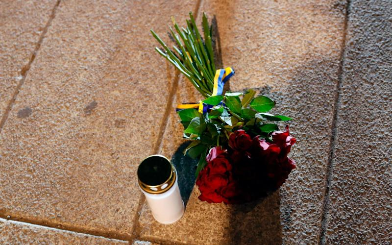 Flowers and a candle have been laid by Swedish Prime Minister Stefan Lofven - Credit: Odd Andersen/AFP