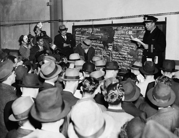 <p>After the accident of the 'Hindenburg' in Lakehurst, NJ, an officer reads the list of casualties to the press on May 6, 1937. ( Heinrich Hoffmann/ullstein bild via Getty Images) </p>