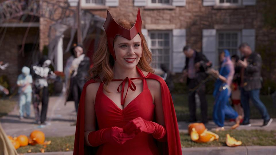 """<p>Wanda's own Scarlet Witch <a class=""""link rapid-noclick-resp"""" href=""""https://www.popsugar.co.uk/Halloween"""" rel=""""nofollow noopener"""" target=""""_blank"""" data-ylk=""""slk:Halloween"""">Halloween</a> costume from the comic books also makes for an awesome option. To get her loose curls you can use a large barrel curling iron or opt for a wig, like the <span>Ivy Hair Scarlet Witch Wanda Maximoff Cosplay Wigs</span> ($19). For the headpiece for this costume, try the <span>WandaVision: Wanda's Scarlet Witch Headdress</span> ($35) or the <span>Red Sorceress Crown</span> ($22).</p>"""
