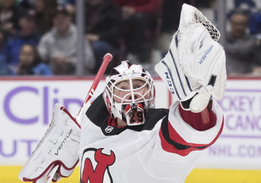 Devils put 2 away fast to beat Canucks at home