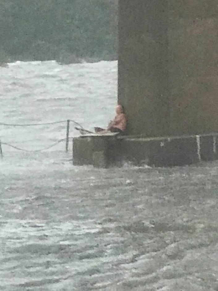 A man was trapped on the pillar under the Theo Baars Bridge in Perdido Key, Florida, after the boat he tried to ride out Hurricane Sally on broke loose in a marina and capsized.