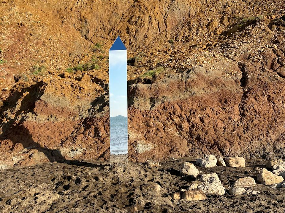 A shiny monolith has appeared on an Isle of Wight beach@AlexiaRFishwick via REUTERS