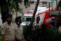 An ambulance is seen parked inside the residence of Bollywood actor Dilip Kumar after he died in a hospital in Mumbai
