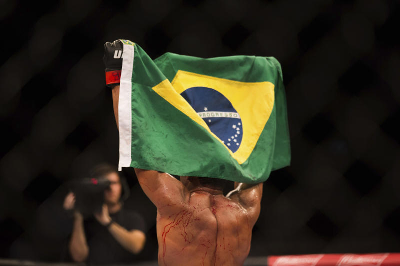 "BRASILIA, BRAZIL - SEPTEMBER 24: Francisco ""Massaranduba"" Trinaldo celebrates after winning a fight against Paul ""The Irish Dragon"" Felder during UFC Fight Night at Nilson Nelson Gymnasium on September 24, 2016 in Brasilia, Brazil. (Photo by Ed Ferreira/Brazil Photo Press/LatinContent via Getty Images)"