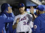 New York Mets' Noah Syndergaard (34) celebrates with teammates after scoring when Robinson Cano was walked with the bases loaded during the fifth inning of a baseball game against the Minnesota Twins on Wednesday, April 10, 2019, in New York. (AP Photo/Frank Franklin II)