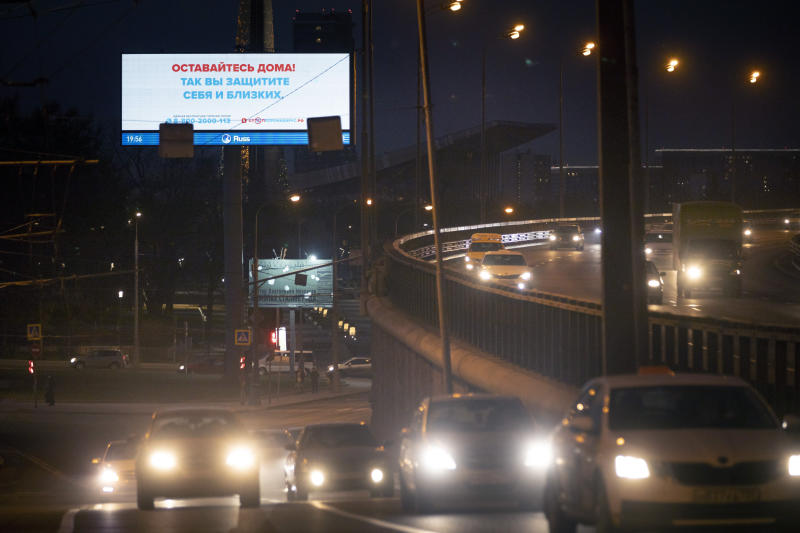 "Cars drive past an electronic billboard reading ""Stay home, take care of yourself and your loved ones"" is displayed in an almost empty Prospect Mira (Peace's Avenue) in Moscow, Russia, Tuesday, April 7, 2020. Putin asked experts whether it would be possible to lift some of the restrictions earlier to ease the pain for the economy. They said next week would show if the lockdown has helped. The new coronavirus causes mild or moderate symptoms for most people, but for some, especially older adults and people with existing health problems, it can cause more severe illness or death. (AP Photo/Alexander Zemlianichenko)"