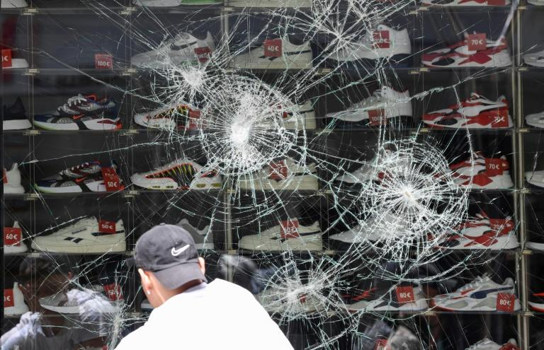 A sportswear shop vandalised early Sunday after hundreds of people ran riot in the south German city of Stuttgart (AFP Photo/THOMAS KIENZLE)