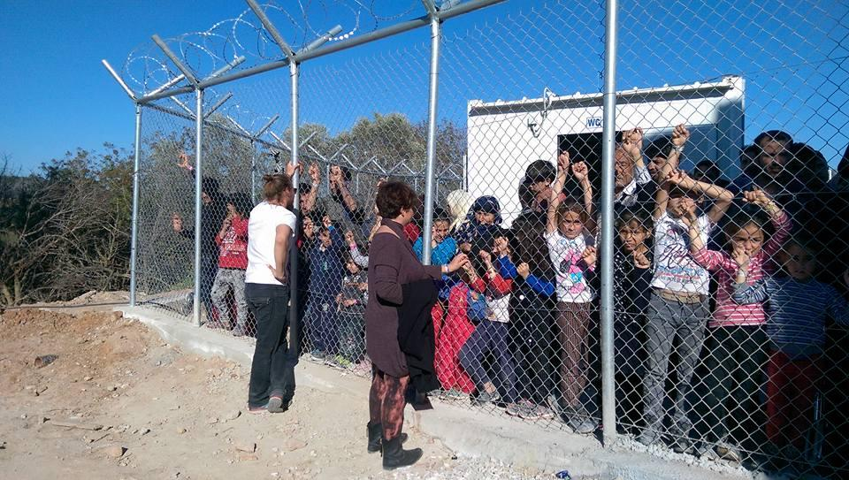 Refugee children behind the fences of Vial refugee camp on the Greek island of Chios in April 2016. PHOTO: Gabrielle Tay