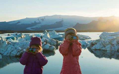 Millennials got their first taste of holiday photography using disposable cameras - Credit: iStock