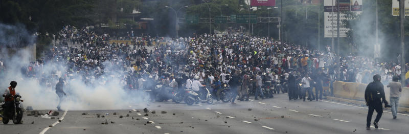 Opponents of President Nicolas Maduro march in Caracas, Venezuela, Thursday, April 20, 2017. Tens of thousands of protesters flooded the streets again Thursday, one day after three people were killed and hundreds arrested in the biggest anti-government demonstrations in years. (AP Photo/Fernando Llano)